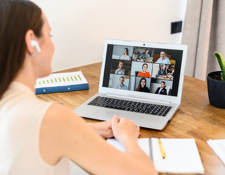 A young professional in a virtual meeting as a digital workplace solution